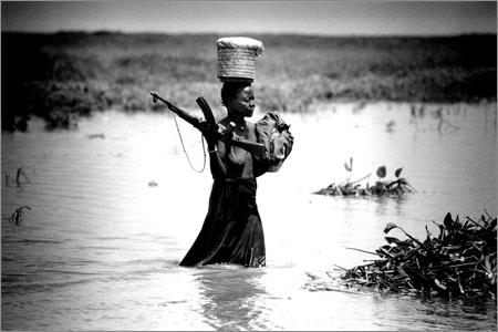 Female SPLA fighter in Southern Sudan.Martin Adler.
